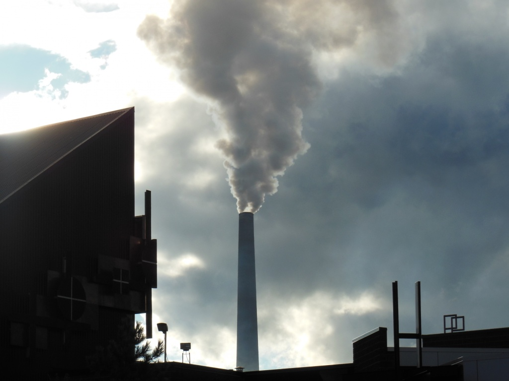 Smoke stalk delivers pollution from burning coal into the sky